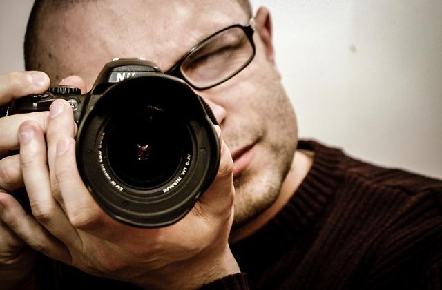 fotografo con reflex